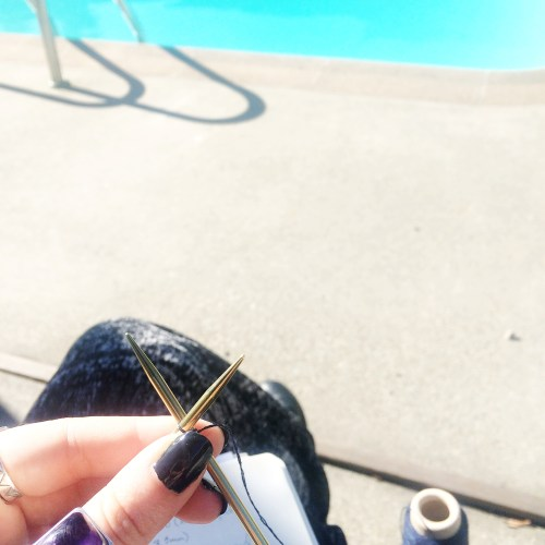 knitting by a pool