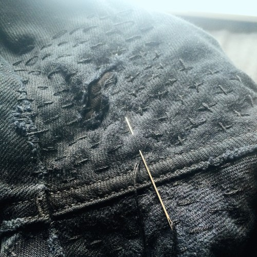 mending a pair of jeans
