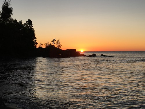 Sunrise on the shores of Lake Superior at Temperance River State Park, Tofte, Minnesota.
