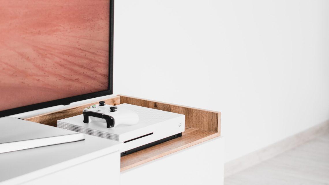 White Xbox One near TV