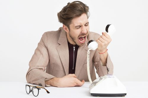 Man shouting into a telephone