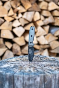 survival knife in log