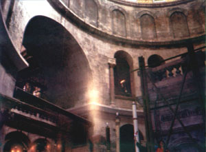 Pilgrim make photo of the Holy Light column (center) and balls of Holy Light (bottom-left)