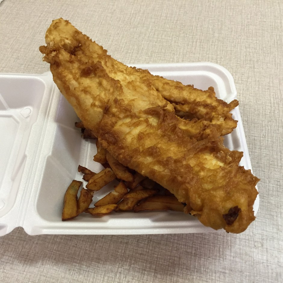 A large order of Fish & Chips before it was cut to fit in the to go box.
