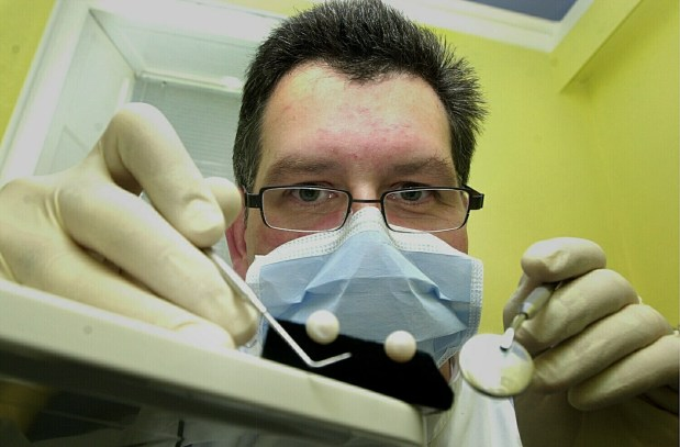 Public relations photo of x-ray tests on pearls by dentist