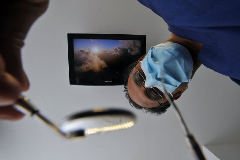 A dental PR photo of dentist carrying out a treatment - patient's eye view