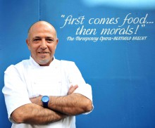Chef poses in front of quote- food and drink pr story