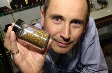 PR photo of Jeweller Alistir Wood Tait with a vial of incredibly rare Scottish gold