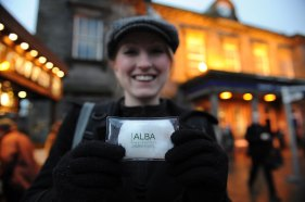 Delighted commuter with her free hand warmer from Alba Residential
