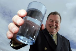 Scottish PR photography JIm Panton headshot holding glass of water