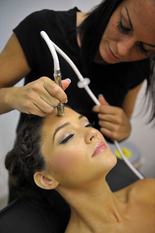 PR in Scotland PR photography model getting face treatment from Sculpta cosmetic clinic