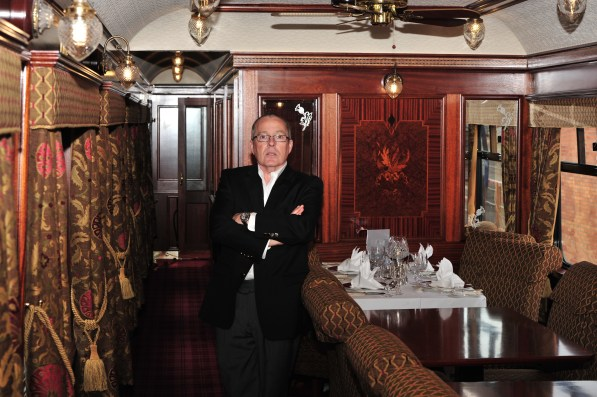 Nigel Woolford in the Swift train carriage he lovingly restored