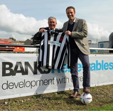 Colin Anderson of Banks Renewables (front) with a club official