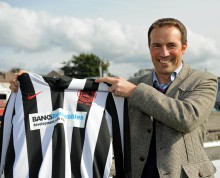 Banks Renewables director Colin Anderson with a Juniors shirt sporting the Banks logo