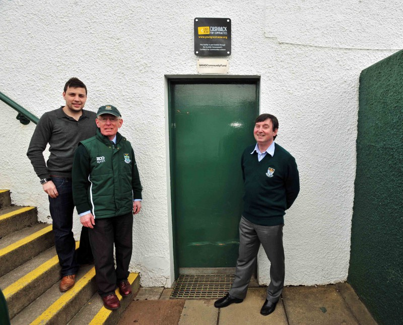 Alistair Landells (right) from Banks Renewables marks the company's donation to Hawick RFC, by meeting with players and officials.