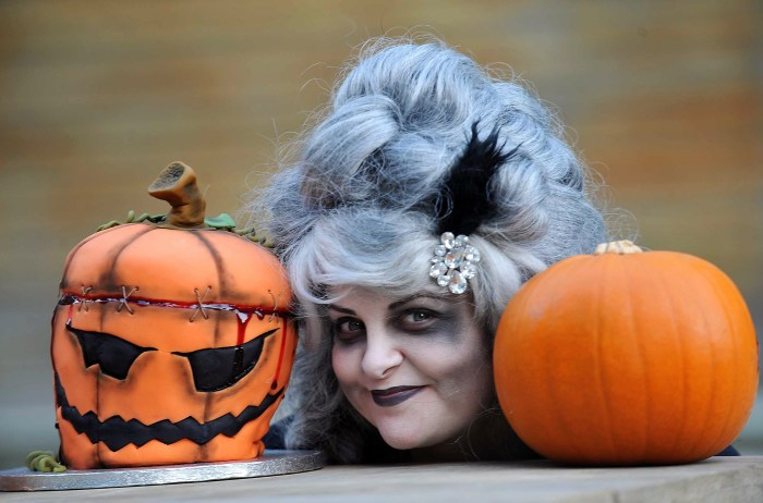 Scary witch with terrifying pumpkin cake
