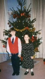 Craig aged 6 with his sister at Christmas