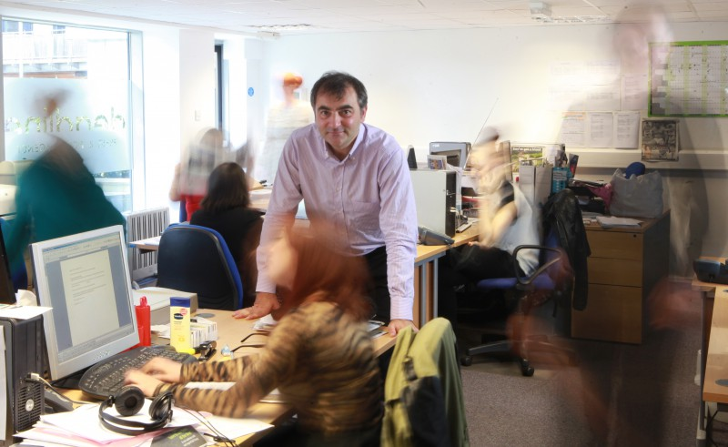 Blurred figures hard at work in the busy pr office of Scottish public relations agency Holyrood PR