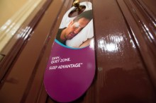 Hotel PR photography of 'do not disturb' sign hanging on the door of a room in a Scottish hotel's specially designated quiet zone