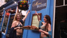 Girls pose in front of new sign- food and drink pr story