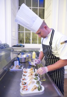 Chef sets out plates- food and drink pr story