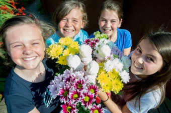 Children pose with flowers as part of Food and Drink PR story