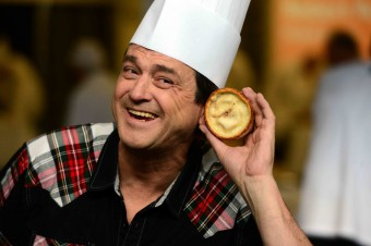 Bay City Roller Les McKeown with a Scotch pie and a baker's hat