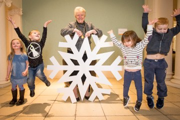 Children witih a giant snowflake help launch Perth Winter Festival
