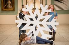 PR photography of Children witih a giant snowflake help launch Perth Winter Festival. Organised by public relations agency Holyrood PR in Edinburgh