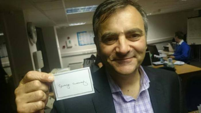Hotel PR experts with George Clooney memorabilia from visit to Edinburgh hotel Tigerlily