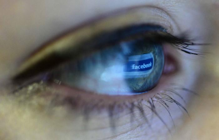 facebook logo reflected in a user's eye