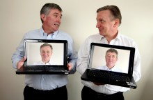 PR Photography for Euro Business Directors: Hold Laptops and Look at each other