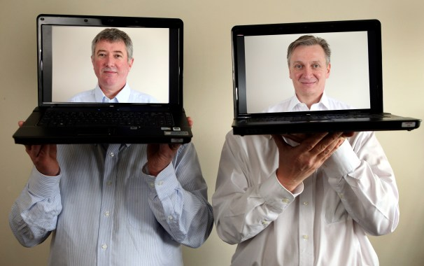 Euro Business Directors Hold Laptops with images representing their faces