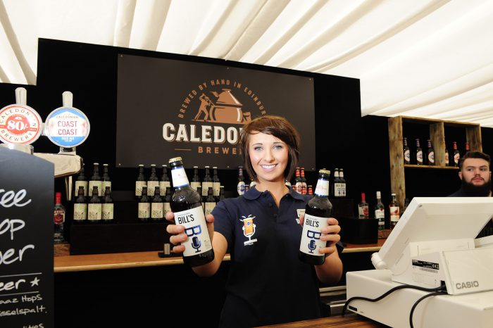 Photo of woman with Caledonian Brewery Racecourse items, working with Edinburgh PR AGency