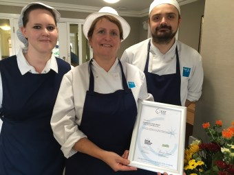3 members of the catering stand with their Eat Safe Award certificate