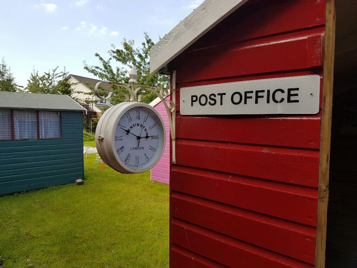 Post Office and clock in dementia village at Bupa care home in Falkirk