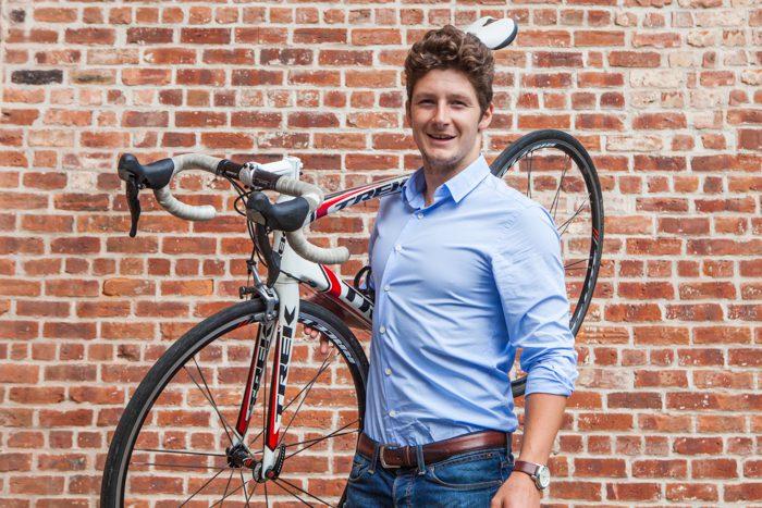 Holyrood PR intern holding bike