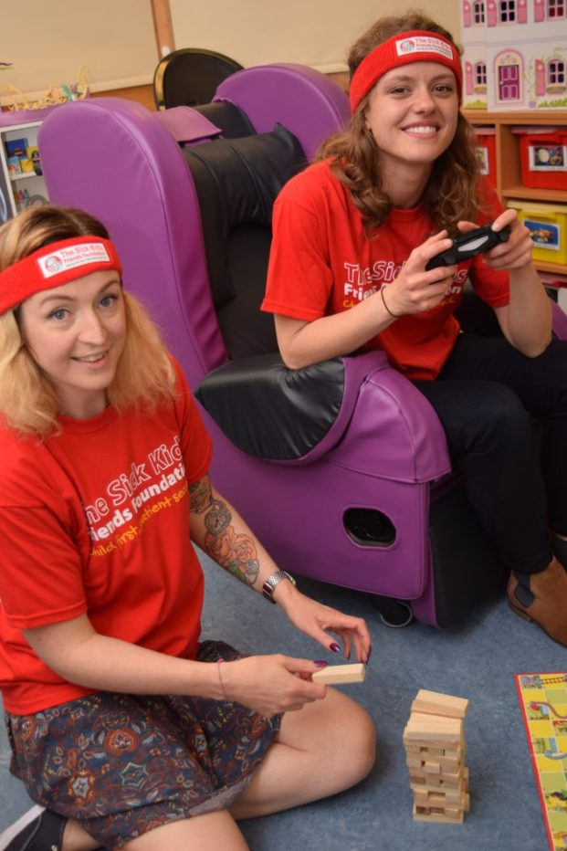Two girls at the Save Point gaming marathon for sick kids