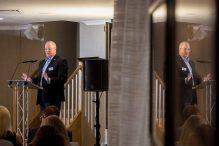 Bield Chair standing at podium addressing crowd by Edinburgh PR Agency