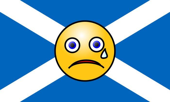Flag for post by Digital PR. Sad Emoji over Scotland flag