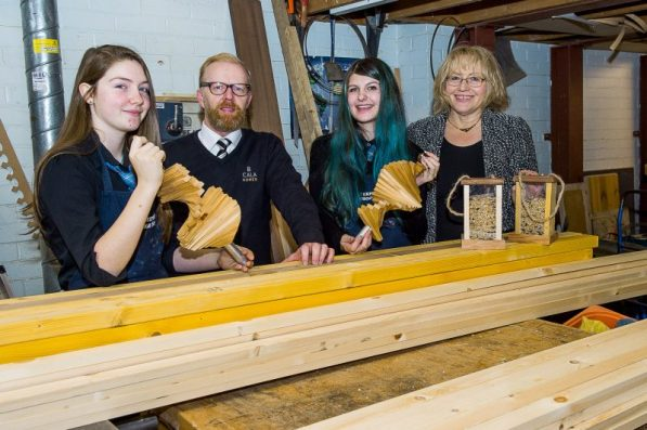 Students showcase their designs with CALA Representative and Teacher as part of PR Photography