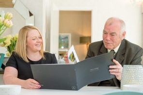 Councillor Ricky Henderson looks over the Kinleith Mills brochure with CALA Homes representative as captured by PR Photography
