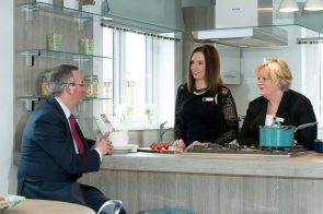 CALA Representatives, Jenny Thomson and Kirsty Summers join Councillor Keith Robson in the kitchen of one the new show homes at Liberton Braes (PR Photography: Wullie Marr)