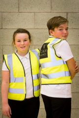 PR Photography captures the moment two children from Loanhead Primary School show off their new high-visibility jackets