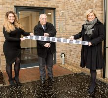 PR Photography shows Councilor Norman Work and sales assistants, Anne Struthers and Dawn Preedy cut the ribbon to open the new Dalmeny Park Apartments, South Queensferry