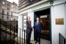 Scott Rasmusen Shakes Hands with Gregor Mair in Merger Story shared through Scottish PR Agency.