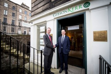 Scott Rasmusen Shakes Hands with Gregor Mair in Merger Story shared through Scottish PR Agency.