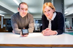 Roddy Hamilton and Lucy Richards show energy saving smart meter