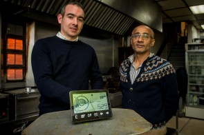 Roddy Hamilton and Farooq Siddique pose alongside the Smart Meter