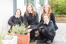 A picture of 4 girls at Woodlands Special School tending to a lavender plant for Photography PR